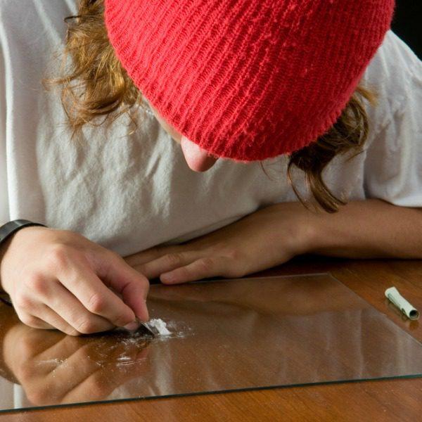 Drug dealer snorting cocaine