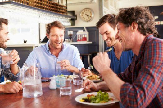 Young men having lunch