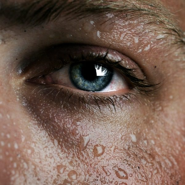 Closeup of eye and sweaty face