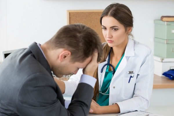Nurse with distraught patient
