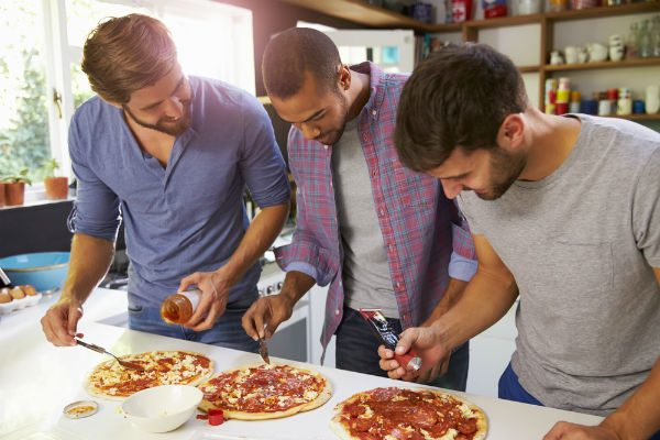 Sober living friends making piza