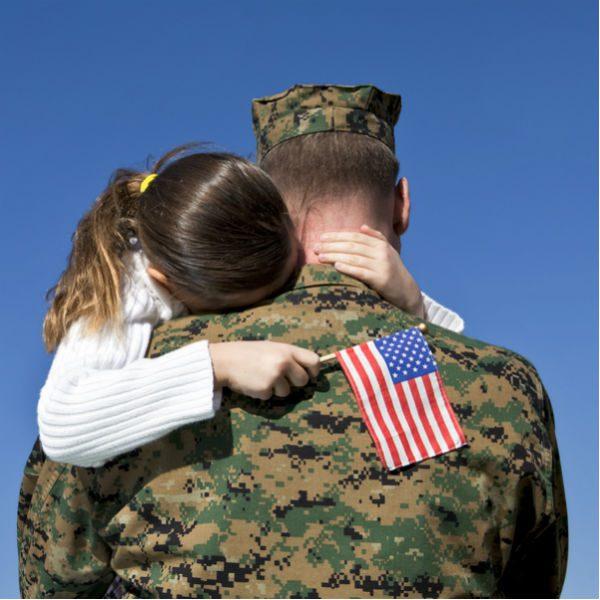 Soldier hugging daughter
