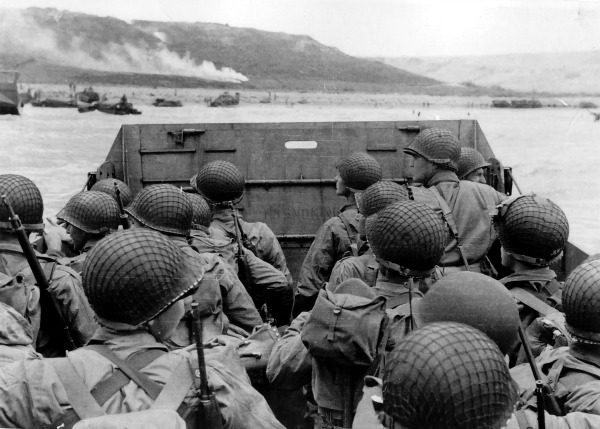 Soldiers landing on Omaha Beach