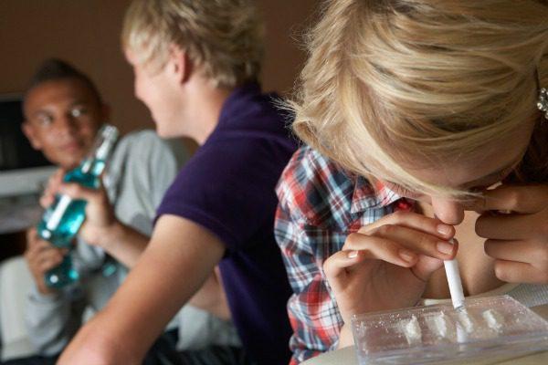 Teen girl snorting coke