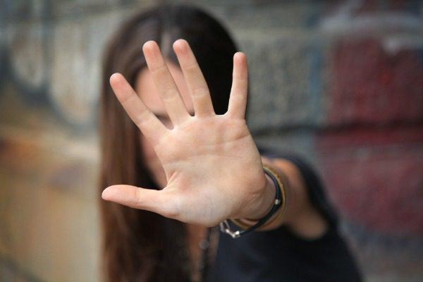 Woman in denial hand up