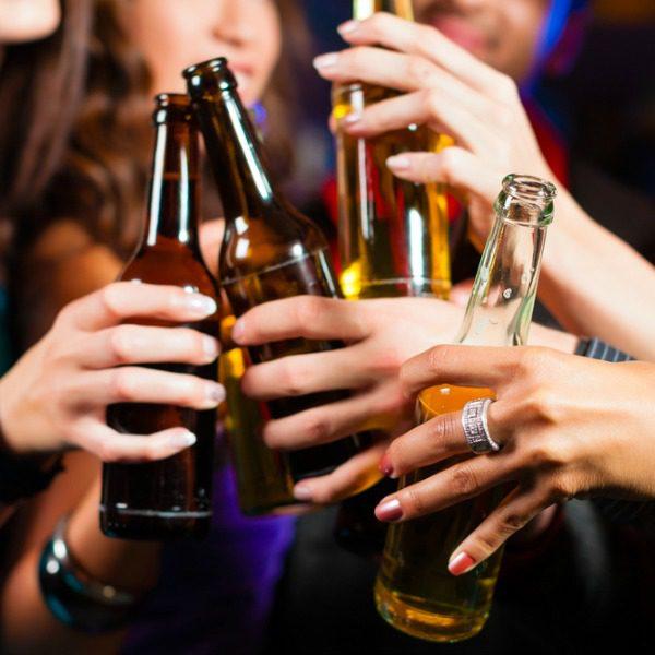 Women toasting beers