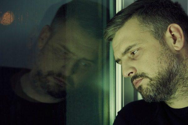 Man in detox by window