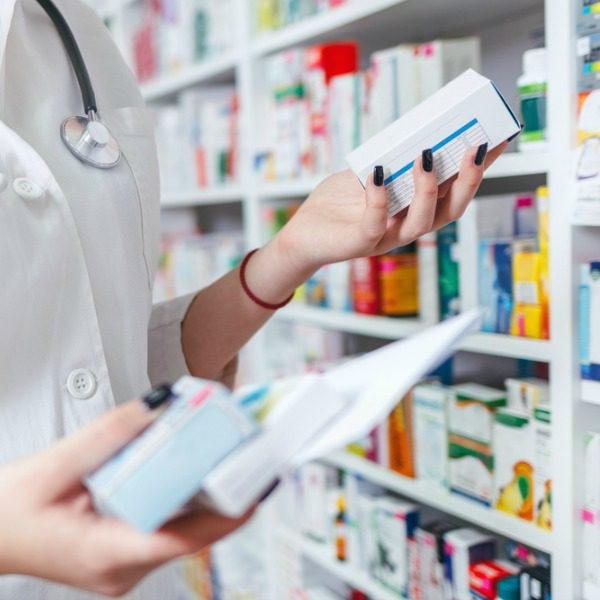 Pharmacist collecting prescription drugs