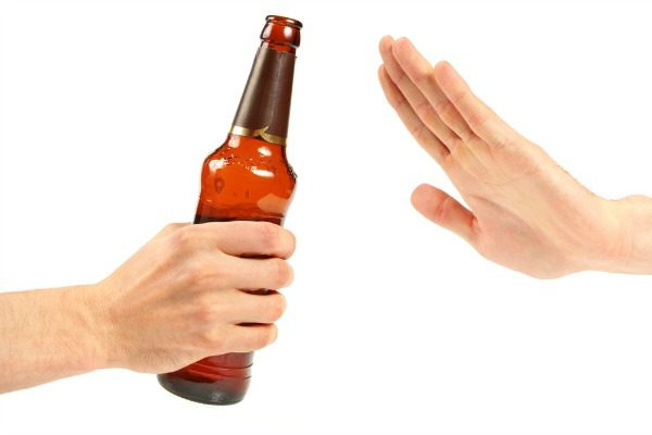 Hand refusing a beer