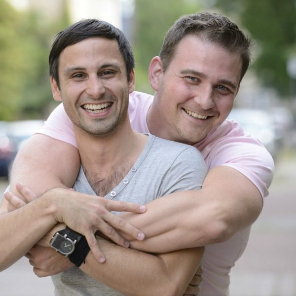 Gay couple hugging