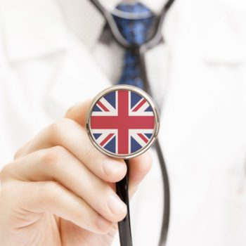 Doctor holding a stethoscope with UK flag
