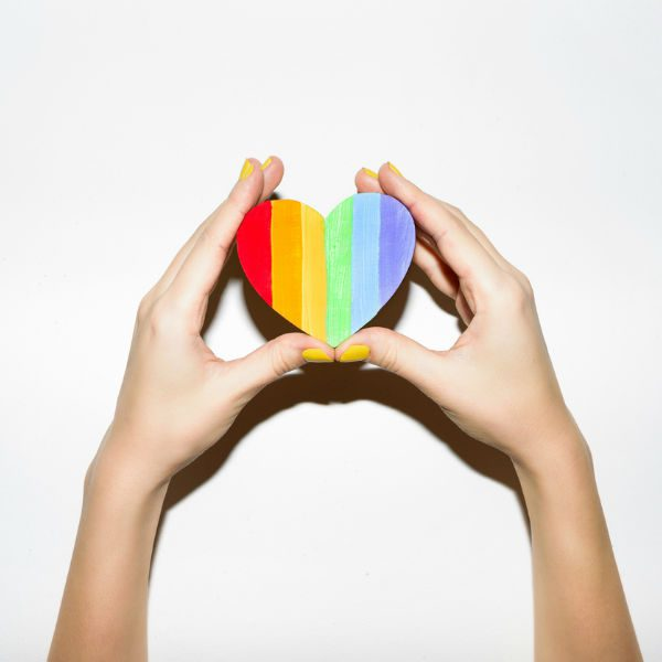 Rainbow heart in hands