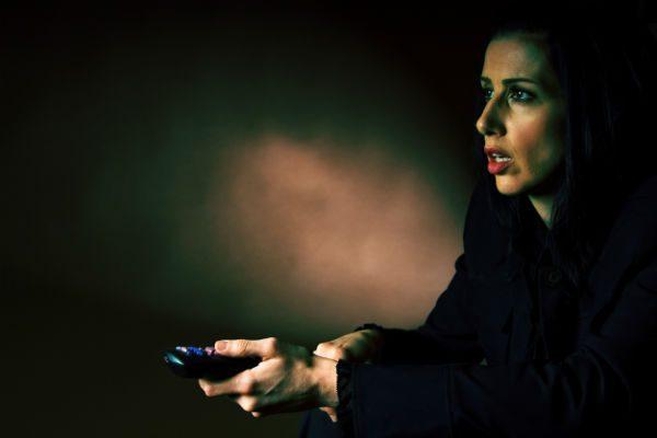 Woman watching disturbing TV