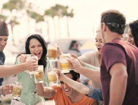Friends toasting beer mugs