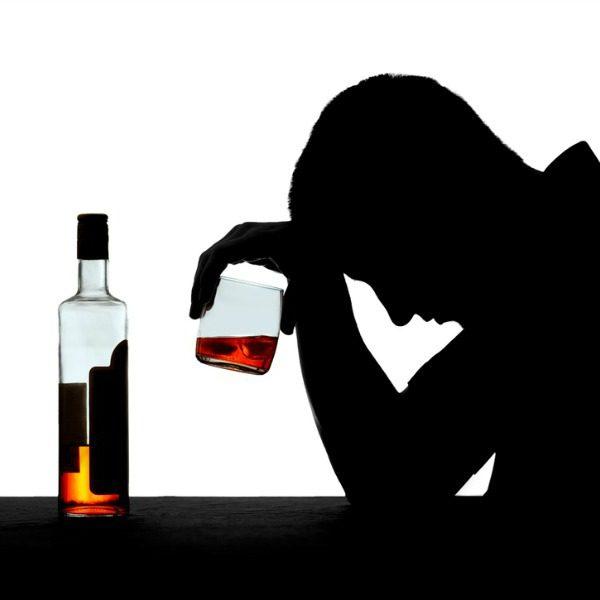 Alcoholic man sitting alone