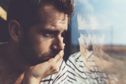 Man alone by window