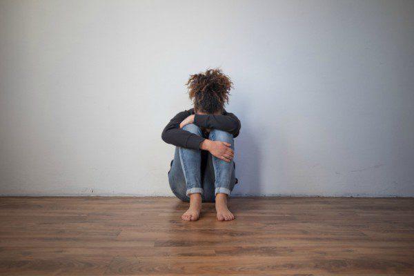 Sad black girl on floor